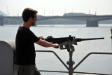 James taking aim at a DPRK sailor on shore