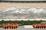 Mosaic of Mount Paektu behind the statue of Kim Il Sung