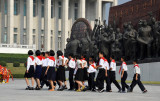 The Young Pioneers approach the statue of Kim Il Sung