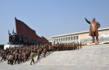North Korean work unit in Mao suits at the Mansu Hill Grand Monument
