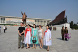 North Korean women posing with American tourists at the Mansu Hill Grand Monument