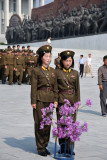 Two North Korean women in uniform at Mansu Hill