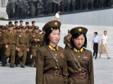 North Koreans in uniform at Mansu Hill Grand Monument