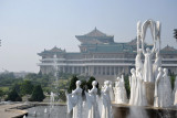 Pyongyang's 28 Female Dancer sculpture with the Grand People's Study House