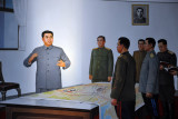 Kim Il Sung planning a battle with his generals