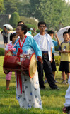 Old North Korean woman with a drum, Moranbong Park