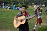 North Korean boy with guitar, Moranbong Park