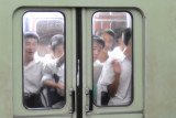 Curious North Koreans glancing out of a subway car