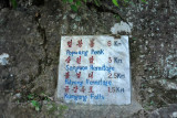 Trail marker for Kumgang Galls, Pulyong Hermitage, Sangwon Hermitage and Popwang Peak