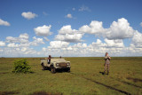 Landcruiser on the flat grassland at the edge of the Bangweulu Swamps