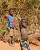 Friendly Zambian boys waving as we pass