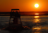 Tour boat on the Chobe River at sunset