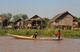Paddling a traditional canoe on Inle Lake