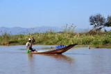 Paddling the traditional canoe of Inle Lake
