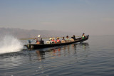 Boat load of tourists speeding across Inle Lake