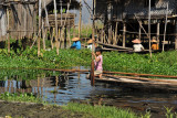 Girl on a canoe in one of the stilt villages in the middle of Inle Lake