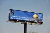 Jordanian telecom billboard with Dome of the Rock