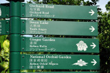 Signs pointing out the attractions in Singapore Botanic Gardens
