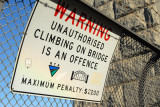 Warning - Unauthorized Climbing on the Bridge is an offence