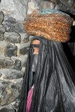 Dubai Museum - woman carrying a basket on her head