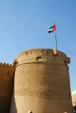 Tower of Al Fahidi Fort flying the UAE flag