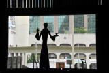 Silhouette of statue by the open door or Rio Cathedral