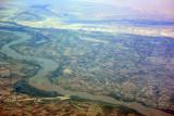 A canal joins the Amu Dar'ya River, Uzbekistan (N41 46.6/E060 33.2)