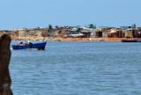 Lagoon and fishermen's village across from the Neto Mausoleum