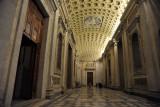 The massive bronze doors are ancient, originally from the Roman Senate (Curia)