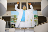 Colossal Gadhafi greets visitors to the Leptis Magna Musuem