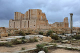 The Roman Theater of Sabratha behind the ruins of the theater district
