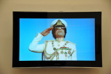 Qadhafi salutes on a video playing in the Gallery of the Revolution of the Museum of Libya, Tripoli