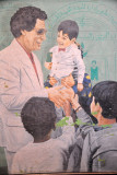 Qadhafi playing with children, Tripoli Medina, 2010