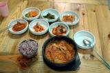 Korean noodle dish with the traditional side dishes