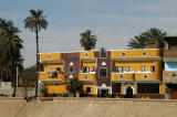 Yellow and brown painted houses just south of Kom Ombo