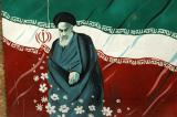 Khomeini with the Iranian flag on the wall of the former US Embassy, Tehran