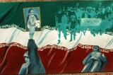Mob with banner reading Death to the Shah and soldier supporting Khomeini