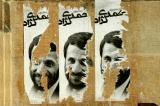 Ripped posters of Iranian President Mahmoud Ahmadinejad