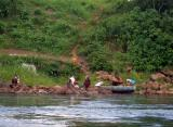 Local people swim, bathe and do their laundry in the Nile