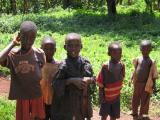 5 boys watching as our van is stuck in the mud