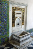There are many ornate water basins and taps