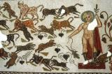 Dionysos, surrounded by animals, El Jem 4th C. AD