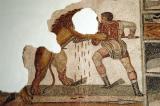 Gladiator (Bellunaire) spears a lion in a Roman amphitheatre