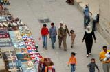Pedestrians strolling down Rue Okba ibn Nafaa along the wall of the Great Mosque