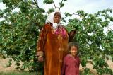 Tunisian woman and her daughter in the apricot orchard