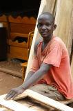 Young carpenter at work, Hoima Rd, Kampala