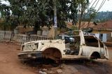 Wrecked and stripped car abandoned on Hoima Road, Kampala