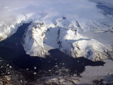 Glaciers flowing down from the Greenland Icecap breaking up into icebergs