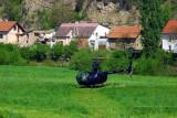 HeliCzech Robinson R44 (OK-HCZ) in the grass near Karlštejn Station