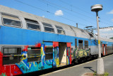 Graffiti-covered Czech double decker train, Beroun Station